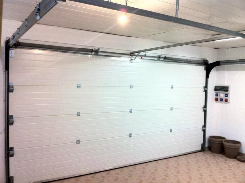saint chaptes 30190 installation d 39 une porte sectionnelle alu motoris e. Black Bedroom Furniture Sets. Home Design Ideas